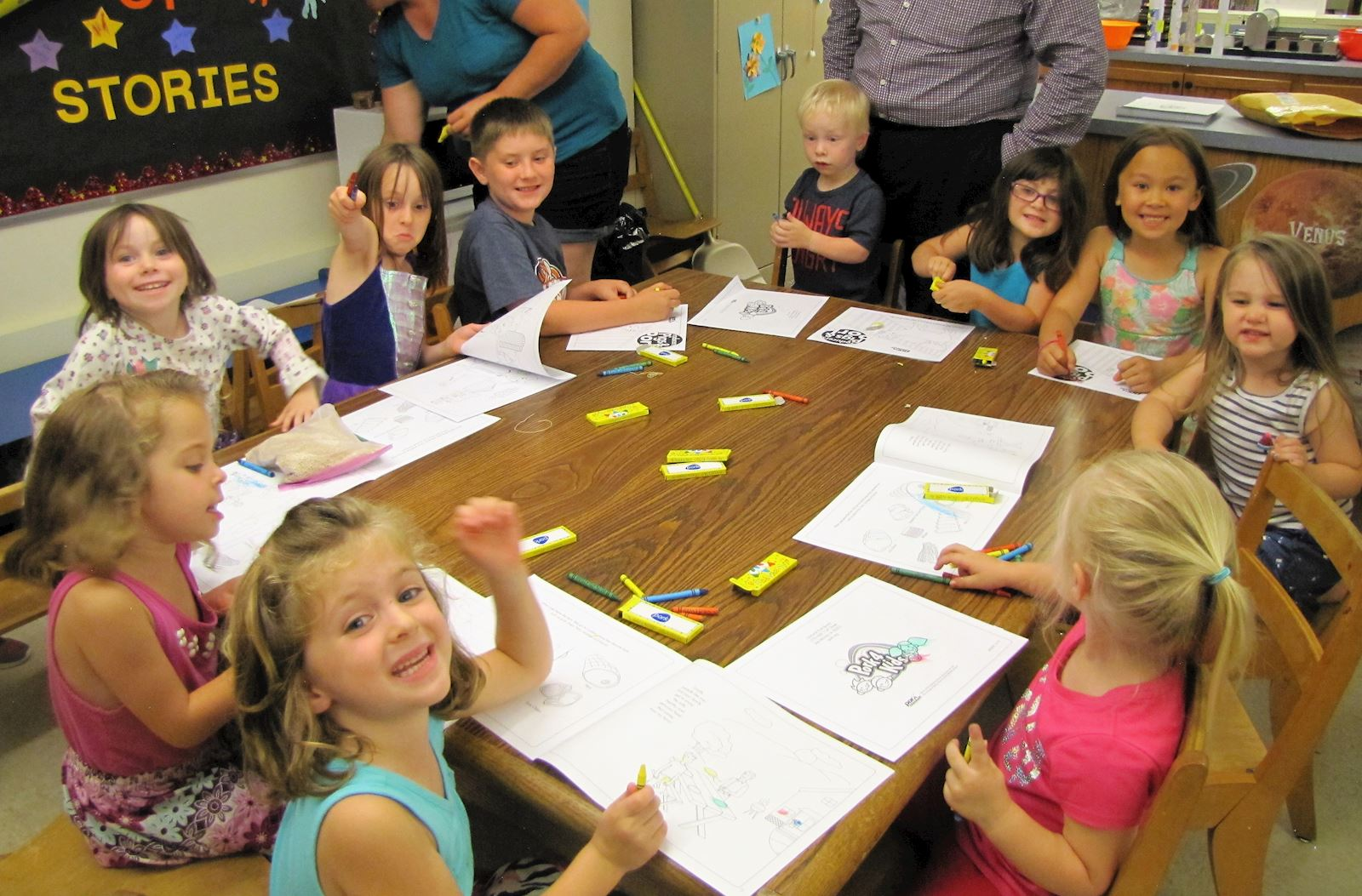 "Children coloring in their ""Producers, Pigs and Pork"" books"